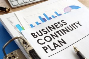 Business continuity plan in a blue folder.
